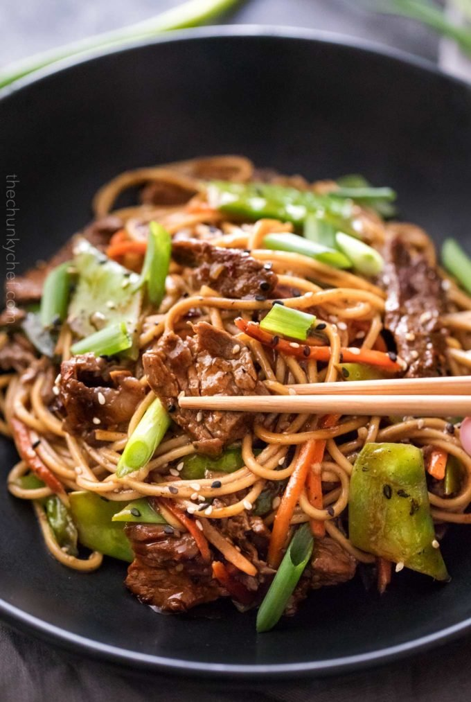 Stir fry with beef and vegetables with chopsticks