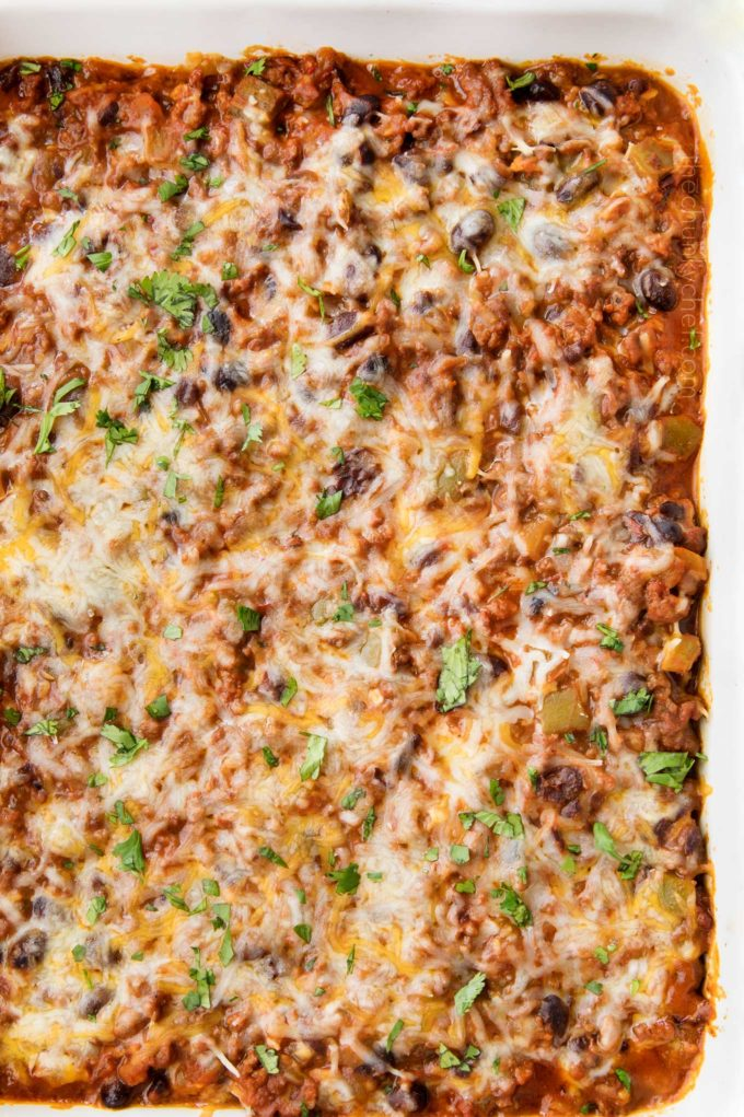 This beef and bean taco casserole is incredibly easy, made from scratch, freezer-friendly, and a huge hit families!