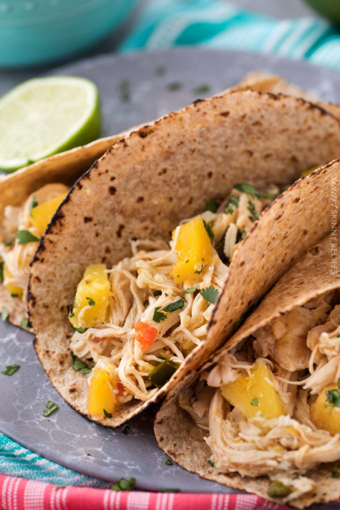 Tender, juicy, sweet and spicy crockpot chicken tacos, perfect for taco night! Just 1 freestyle smart point per serving means you can have tacos without the guilt!