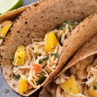 Tender, juicy, sweet and spicy crockpot chicken tacos, perfect for taco night! Just 1 freestyle smart point per serving means you can have tacos without the guilt! | #chickentacos #tacotuesday #crockpot #slowcooker #weightwatchers
