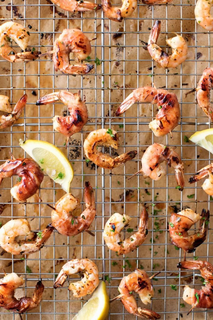 Prosciutto wrapped honey lemon shrimp on baking sheet