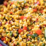 This Southwest cilantro lime corn salad is bold, healthy, and incredibly versatile! At zero smart points per serving, feel free to pile it on tacos for an amazing meal!   #cornsalad #mexican #southwest #cilantro #lime #tacotuesday