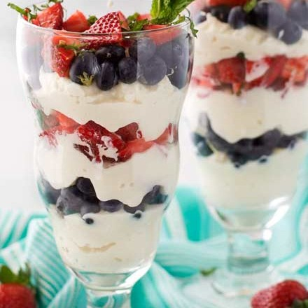 Perfect for Memorial or Independence Day, these berry ricotta parfaits are easy to make, and lightened up so you don't feel guilty about having dessert! | #healthydessert #parfait #berry #weightwatchers #smartpoints