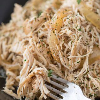 Easy all-purpose shredded chicken made in the crockpot with spices and beer. Make a big batch and use it to make different meals all week long! | #chicken #shreddedchicken #pulledchicken #beer #braised #allpurpose #multipurpose #slowcooker #crockpot