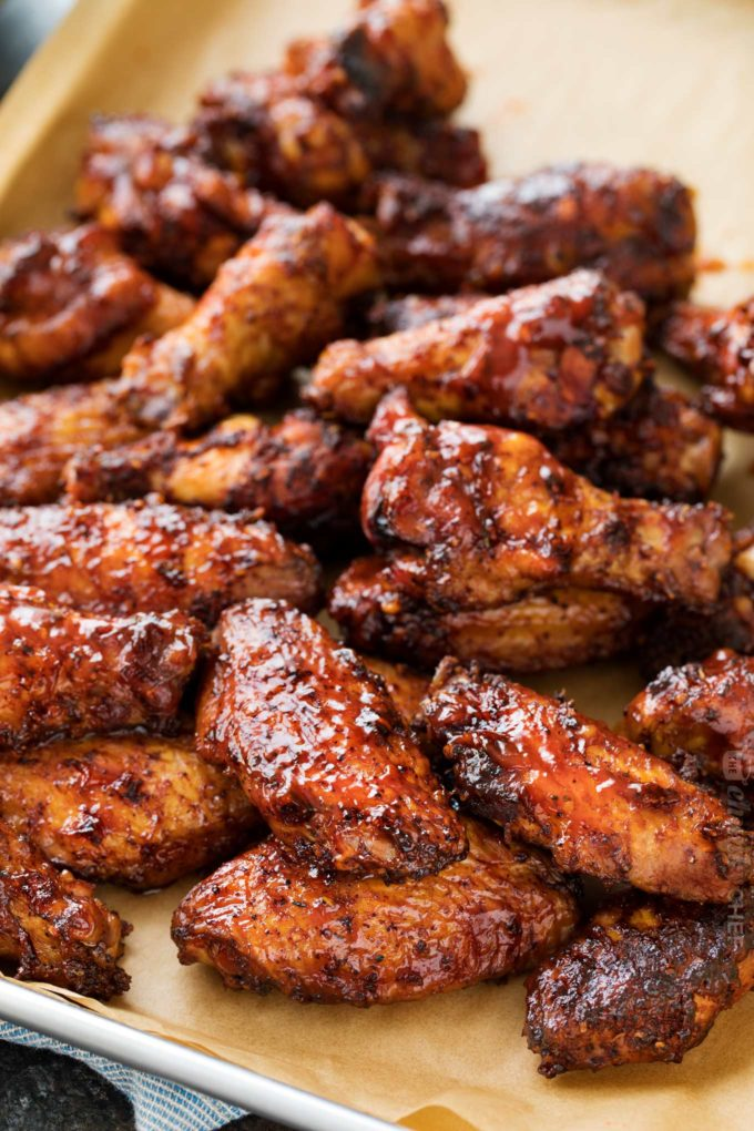 Smoked chicken wings coated with bbq sauce