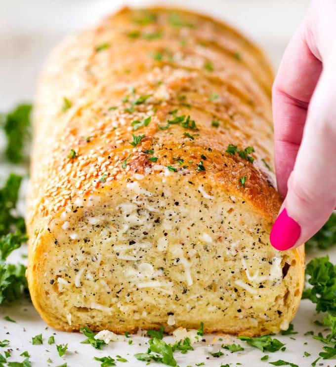Taking a slice of garlic bread