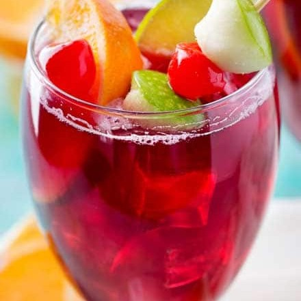 This copycat recipe of Applebee's popular red apple sangria is crazy spot on, and is super easy to make! Easy to adjust to make for a crowd! #copycatrecipe #sangria #redapplesangria #redsangria #applebeesrecipes #drinkrecipe