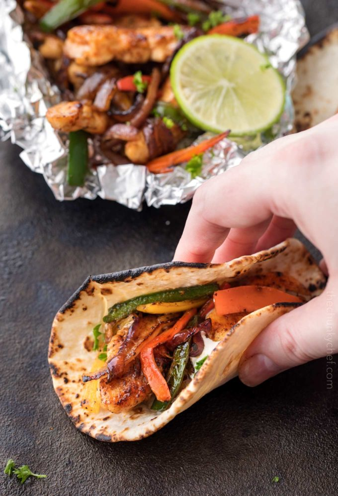Grabbing a chicken fajita made in a foil packet
