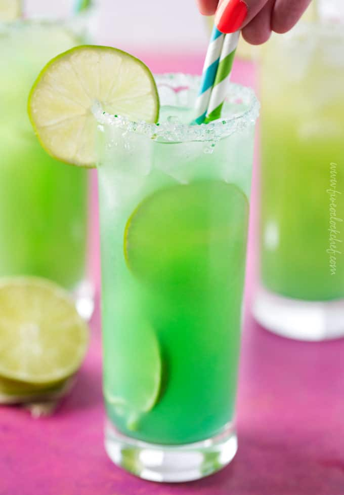 Blue green color of mermaid rum punch cocktail
