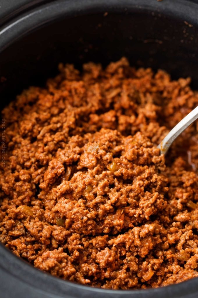 Big spoonful of beef taco meat in slow cooker