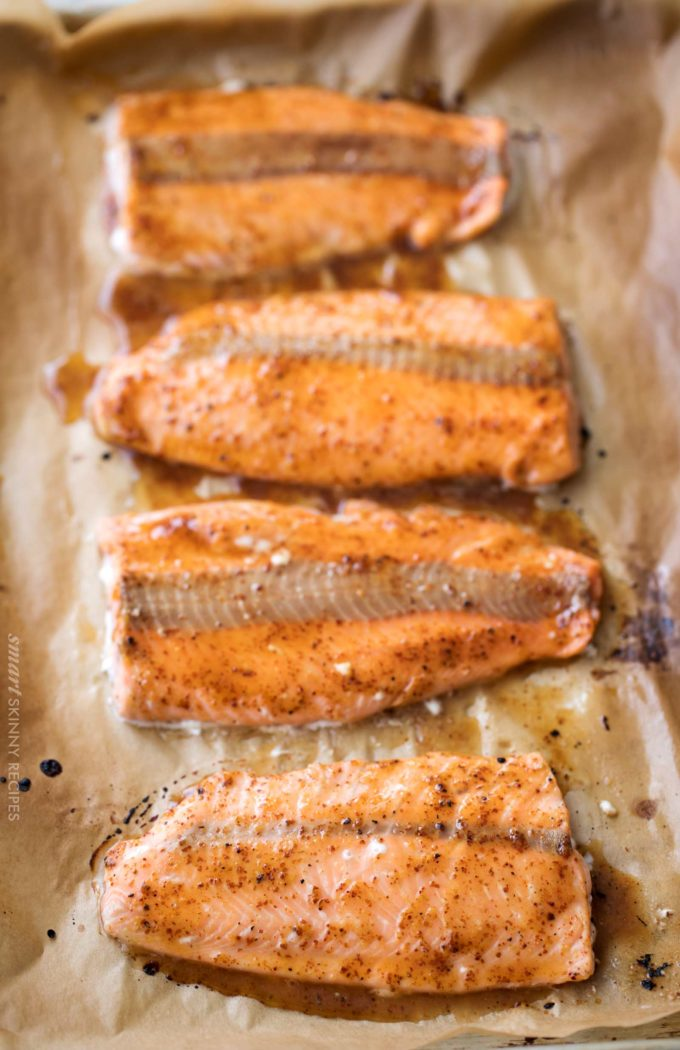 Salmon filets on baking sheet