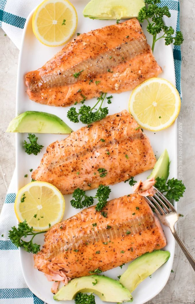 Broiled salmon filets on serving plate with citrus