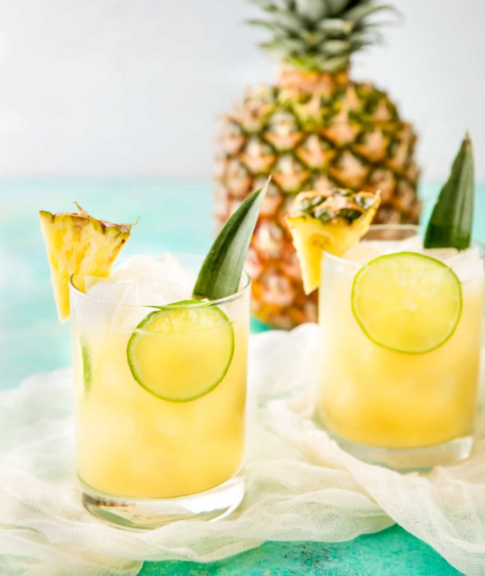 Pineapple rum punch with limes in glasses