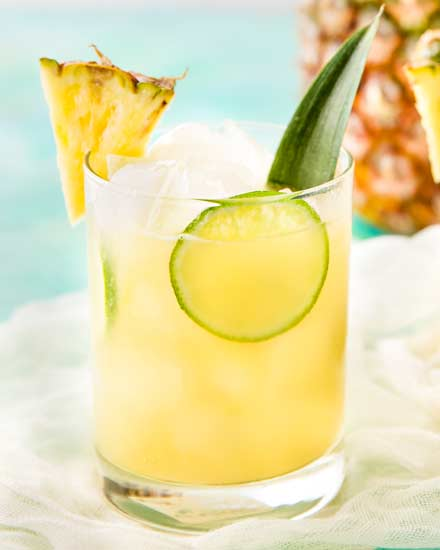 This tropical pineapple coconut rum punch is sweet and a perfect drink for a party!  Drinking this cocktail will make you feel like you're at the beach! #drinks #cocktail #pineapple #coconut #rum #tropical #party
