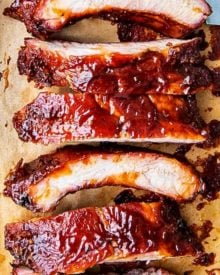 Delicious homemade smoked ribs are easier to make than you think, especially using the popular 3-2-1 method. Fall of the bone tender, and lip-smackingly good, these ribs are FABULOUS!! #ribs #pork #bbq #smoked #smoking #grilling #easyrecipe