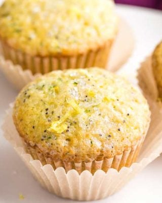 Bakery-style lemon poppy seed muffins with grated zucchini that have the most amazingly soft and fluffy texture, and are complete with a crunchy sugary crust on top! #muffins #lemon #poppyseed #zucchini #bakerystyle #easyrecipe #brunch #breakfast