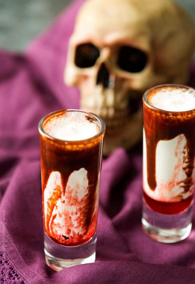 Gory and delicious, these vanilla milkshake shots take just 5 ingredients to make, and are perfect for a Halloween party! #shots #milkshake #halloween #party #fall #boozy #drink