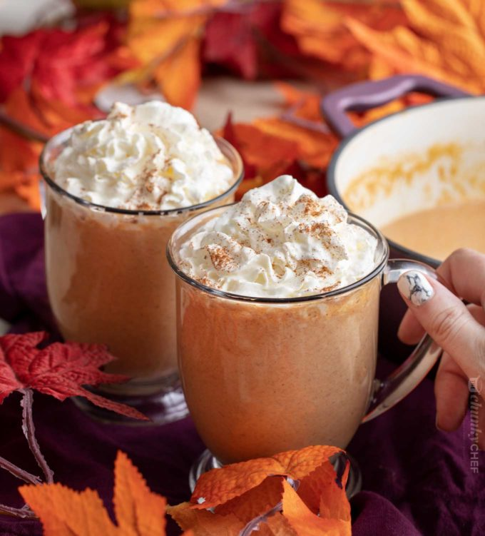 Holding a mug of pumpkin hot chocolate with pumpkin spice