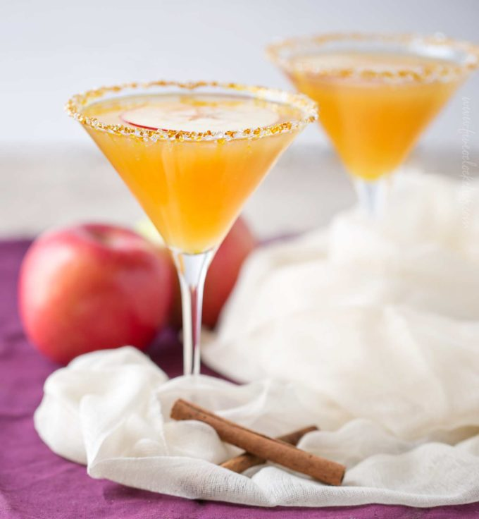 Two caramel apple martinis with sugar rims