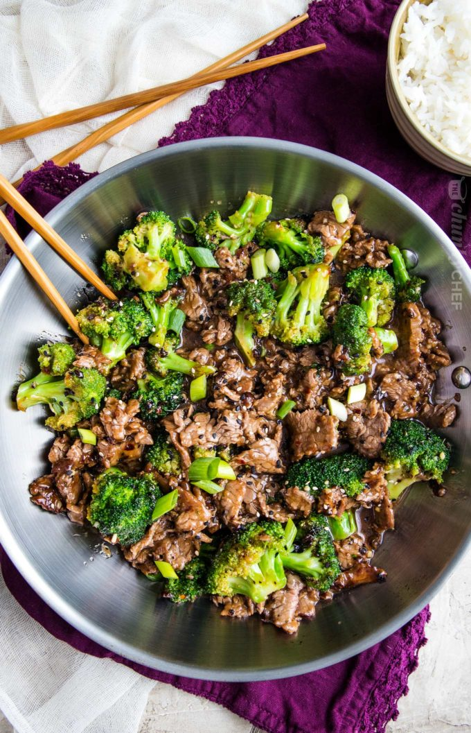 Beef and broccoli in skillet with chopsticks