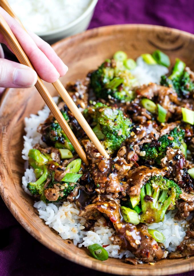 Wooden bowl of beef and broccoli over rice