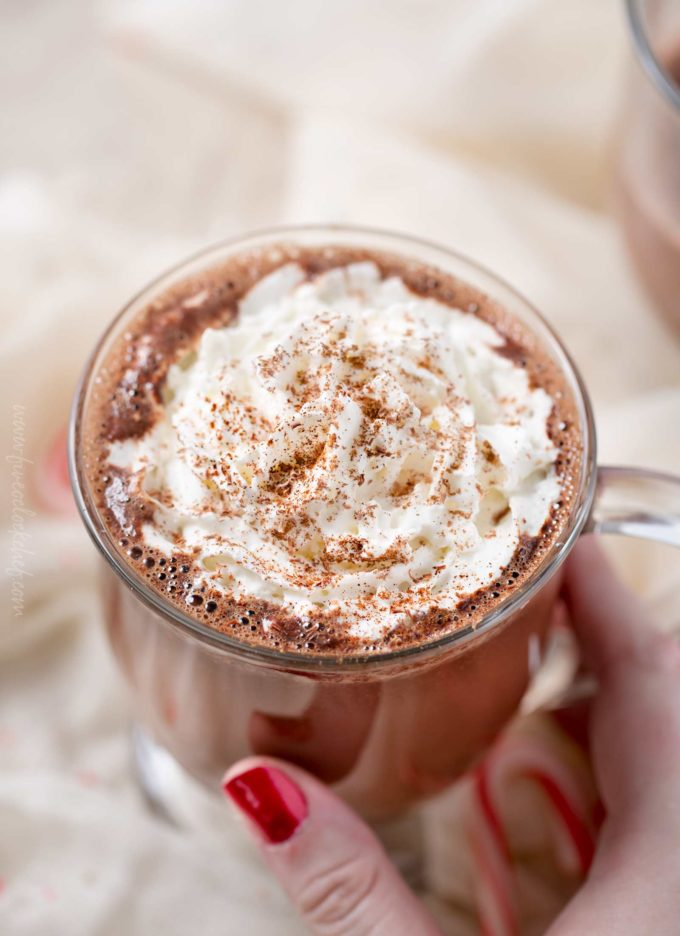 Rich and creamy, Mexican hot chocolate will warm you up from the inside out! Made with melted chocolate, vanilla, cinnamon and a pinch of cayenne for kick, this recipe is easy to spike for an adult beverage treat! #hotchocolate #mexicanhotchocolate #holidaydrink #hotchocolaterecipe #easyrecipe #homemade #hotcocoa