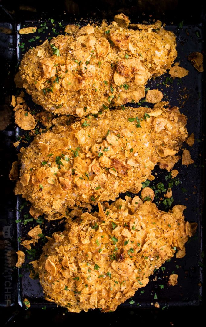 Cornflake chicken breasts in baking dish