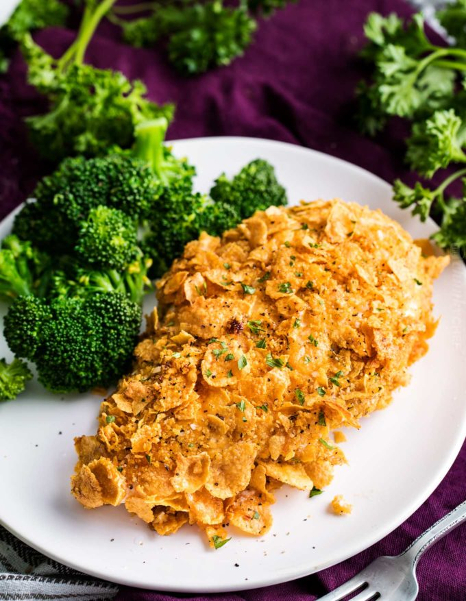 Baked cornflake chicken on plate with broccoli