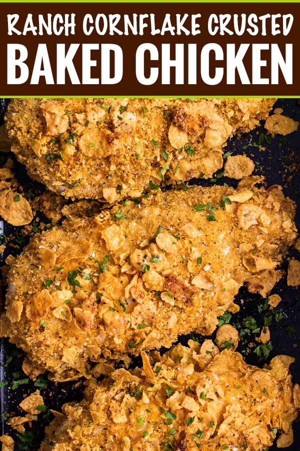Crunchy, juicy baked chicken made by slathering chicken breasts in ranch dressing then coating in seasoned cornflakes.  All the satisfying crunch of fried chicken, but with less fat and more flavor! #chicken #cornflake #baked #easyrecipe