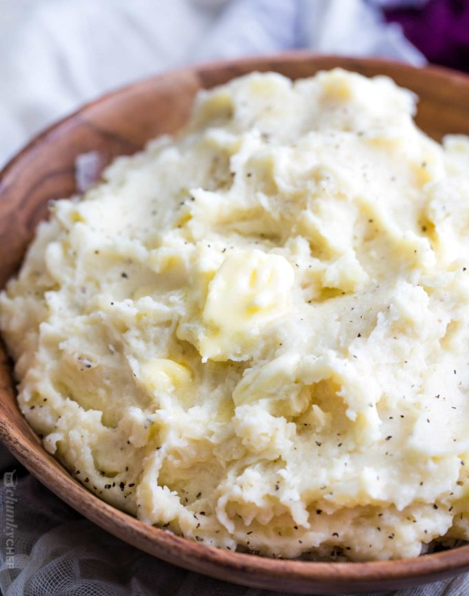 Homestyle mashed potatoes in wooden bowl