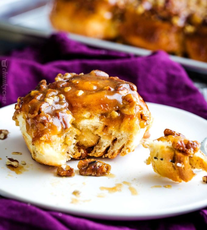Deliciously tender, sweet and sticky, these sticky buns are made with a homemade maple-caramel sauce that is out of this world! #stickybuns #sweetrolls #cinnamonbun #pecan #caramel #holiday #breakfast #dessert