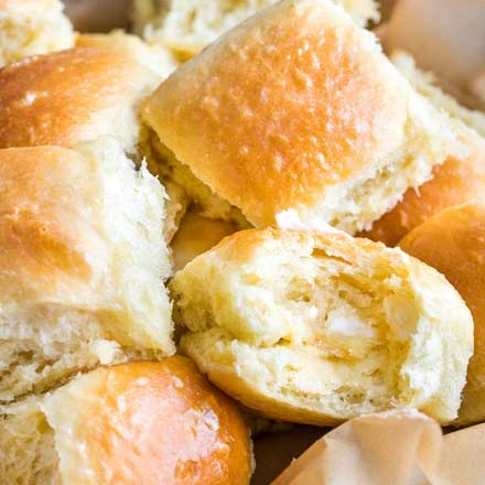 These easy, foolproof homemade dinner rolls served with whipped honey butter are perfect for your Thanksgiving or holiday dinners! With a make-ahead option, you'll be amazed at how easy it is to make bakery-quality rolls in your own kitchen! #dinnerrolls #rolls #thanksgiving #bread #homemaderecipe #yeast #honeybutter
