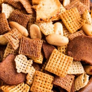 Always a crowd pleaser, this bold and zesty chex mix recipe is made SO simply, right in the crockpot!  Great for any party, and easy to customize! #chexmix #party #snackrecipe #partyfood #bold #chex #slowcooker #crockpot #easyrecipe #homemade
