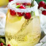 Sweet and festive, this white sangria recipe is full of Christmas cheer!  Easy to make for holiday entertaining, and can be made non-alcoholic as well! #sangria #white #christmas #holiday #winter #alcohol #drink #party #whitewine
