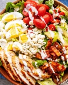 This classic Cobb salad is made with seared chicken breasts, crunchy bacon, sweet tomatoes, creamy hard-boiled eggs, buttery avocado and drizzled with a fantastic and low-carb homemade ranch dressing!  Perfect for Keto and low-carb living! #salad #cobb #lowcarb #keto #healthyrecipe #saladrecipe #ranchdressing #homemade #easyrecipe