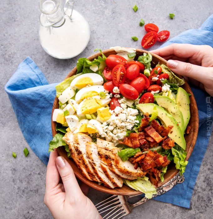 Holding a bowl of keto Cobb salad