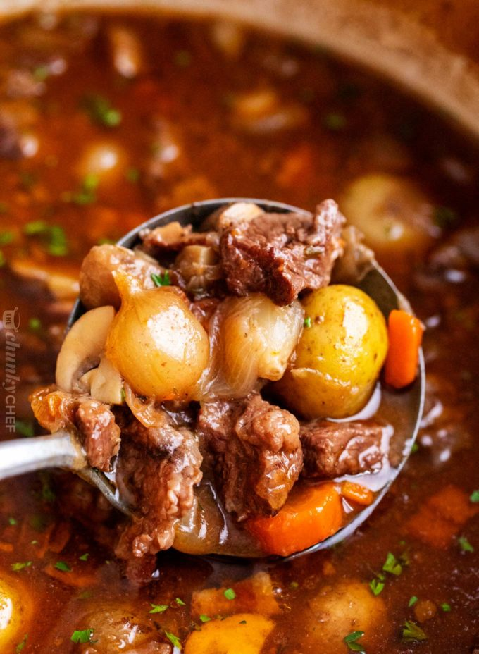 Crockpot Beef Bourguignon has melt in your mouth beef and hearty vegetables simmered all day in a rich red wine gravy!  The ultimate winter comfort food!  Slow cooker, oven, stovetop and instant pot directions! #beefstew #beefbourguignon #slowcooker #crockpot #comfortfood #dinner #easyrecipe #beef