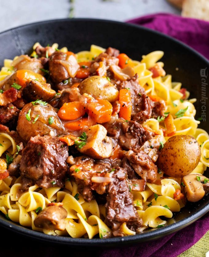 Beef bourguignon over egg noodles