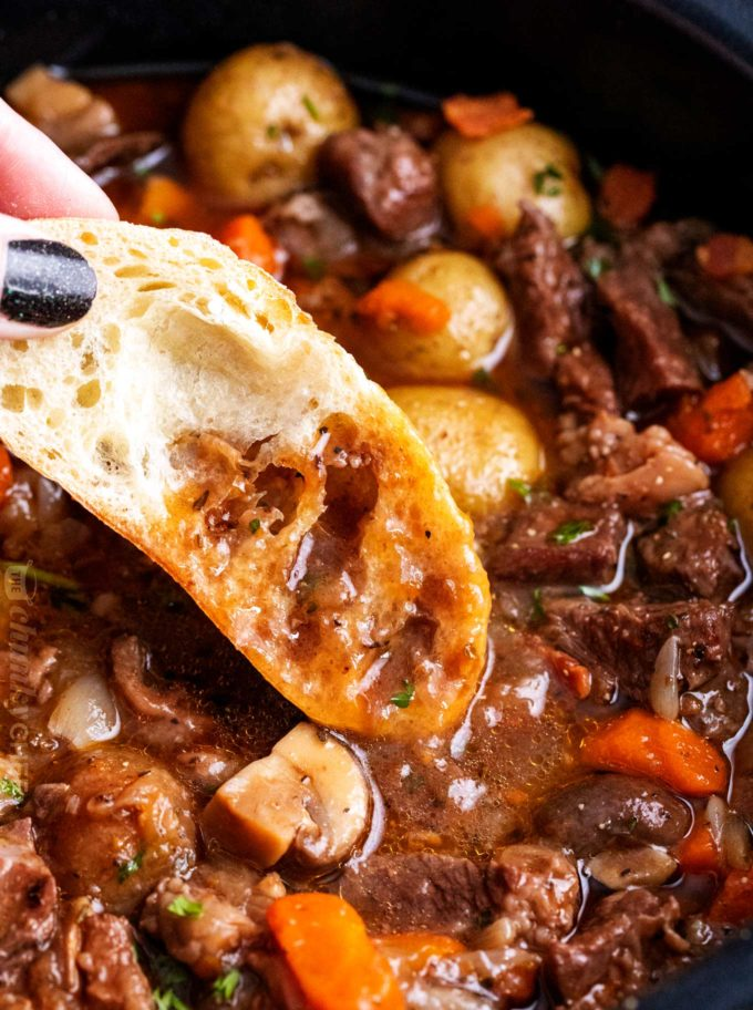 Bread dipped in beef bourguignon