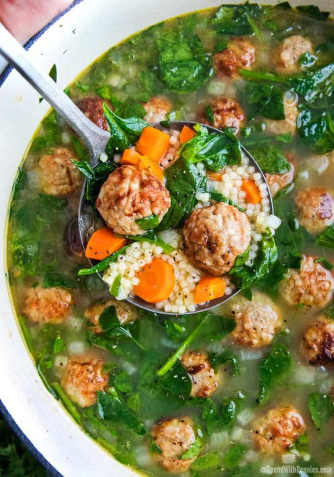 Italian wedding soup in ladle