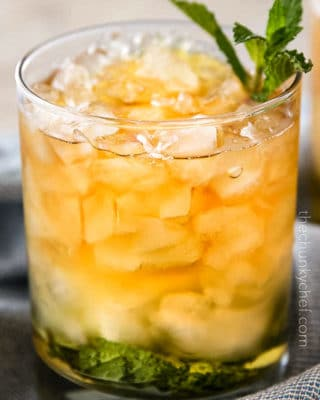 This Southern mint julep recipe is pretty close to the iconic Derby Day cocktail, made with simple syrup, Kentucky bourbon, fresh mint, and crushed ice.  Cool and refreshing, it's perfect on a summer day! #mintjulep #bourbon #derbyday #cocktail #mint #kentucky #southern #sipper