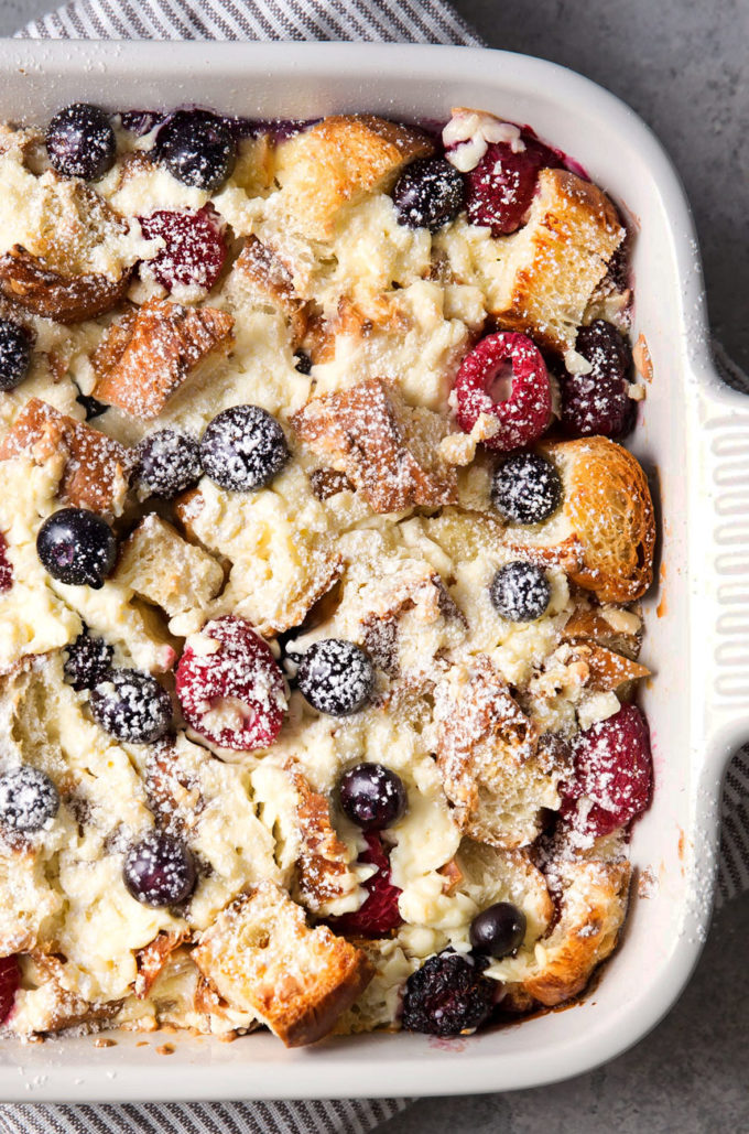 Overhead view of sweet breakfast bake in baking dish with powdered sugar