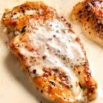 Tender chicken breasts smothered in a rich garlic cream sauce, all made in the same pan, and ready in less than 30 minutes! #easyrecipe #weeknightdinner #dinnerrecipe #chicken #garlic #creamy #onepan #onepot #skilletmeal