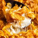 Funeral potatoes, aka Cheesy Potato Casserole, the hot side dish that EVERYONE loves.Perfect for any dinner, holiday or potluck! Rich, cheesy and creamy hashbrown potatoes topped with buttery cornflakes and baked until golden and crispy! #potatoes #cheesy #potatocasserole #funeralpotatoes #partypotatoes #sidedish #potluck #holiday #hashbrown #baked #casserole