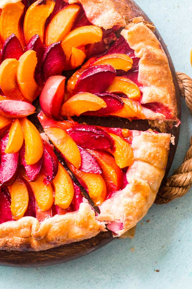 Serving a slice of stone fruit galette