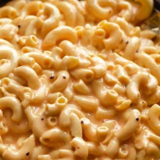 Slow Cooker Mac and Cheese is ultra creamy, and SO easy!  No boiling pasta, no velveeta, and no condensed soups needed.  Perfect side dish or kid-friendly dinner option! #macandcheese #macaroniandcheese #crockpot #slowcooker #easyrecipe #sidedish #potluck #holiday