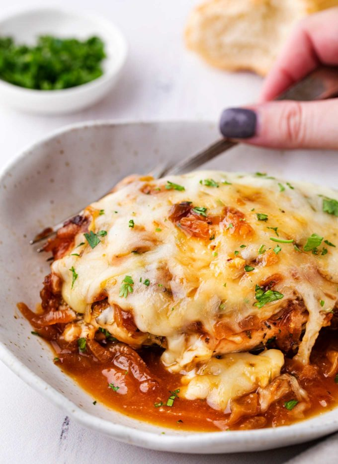 French onion baked chicken on white plate