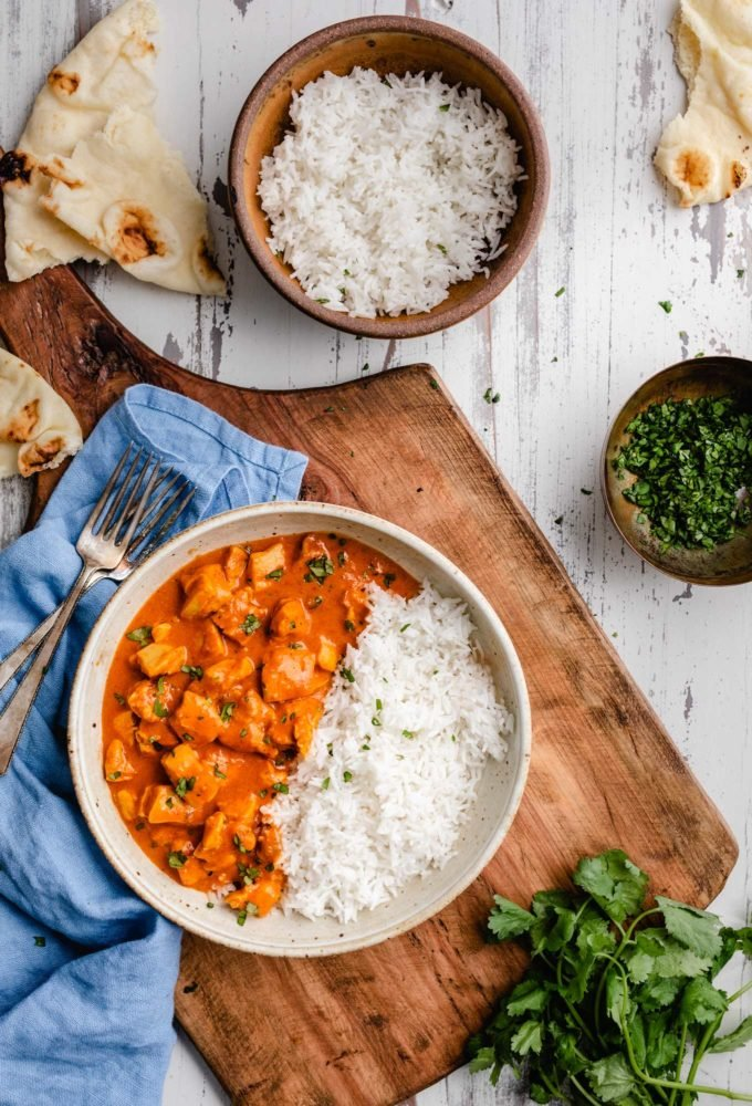 This Slow Cooker Chicken Tikka Masala is the easy homemade version of your Indian food-loving dreams!  Bold and flavorful, yet with a fraction of the work! #chickentikka #tikkamasala #curry #indianfood #slowcooker #crockpot #easyrecipe