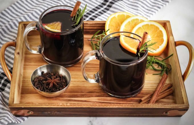 Mulled wine in glasses on serving tray