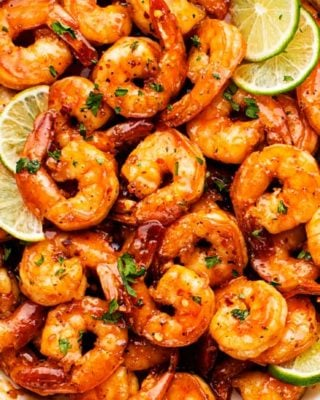 Spicy Honey Lime Shrimp, a quick, 15 minute one pan recipe that's perfect for weeknight dinner!  Garlicky, sweet, and spicy, these shrimps are perfect as a main dish, taco filling, or on a salad! #shrimp #honeylime #spicy #15minutemeal #easyrecipe #quickdinner #weeknightrecipe #dinner #seafood